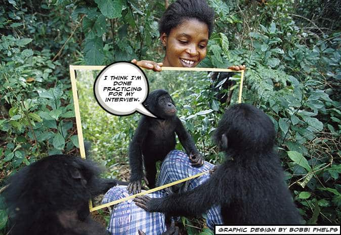 Women holding up a mirror for the monkey to see it's own reflection. interview anxiety